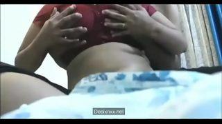 Bhabhi's big boobs pressed in a hotel